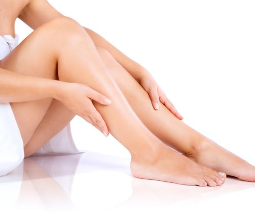 Woman legs and hands, in towel